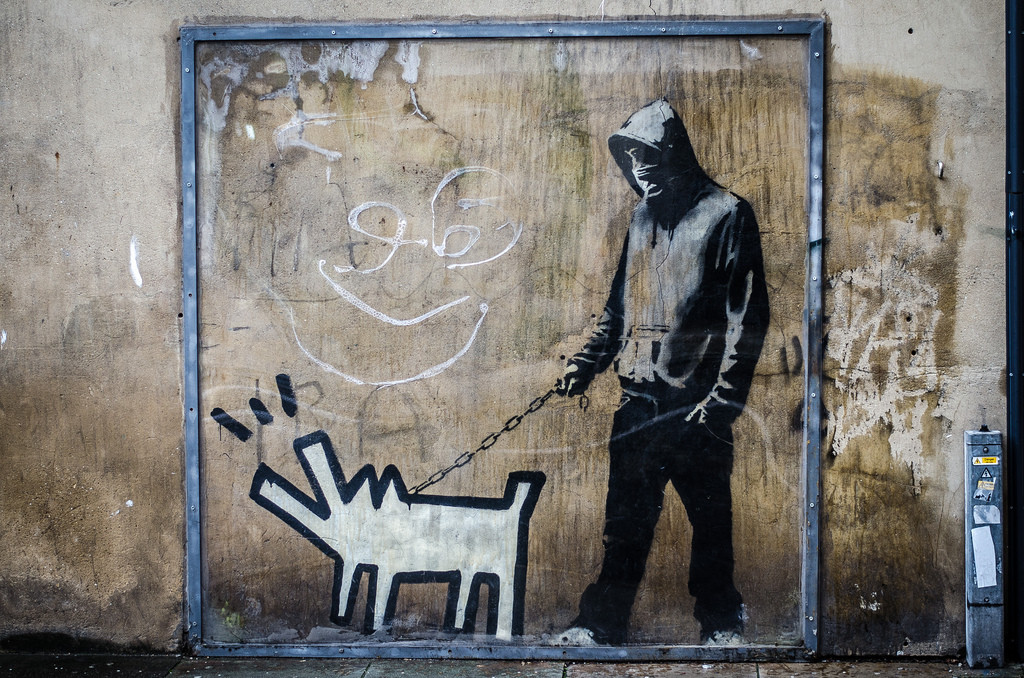 Choose your weapon dog by Banksy
