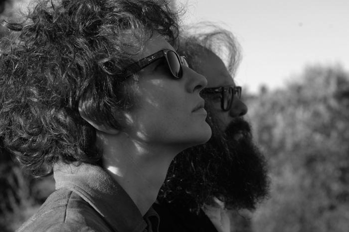 Dylan (Blanchet) e Ginberg (Cross)